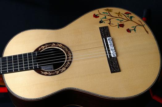 http://www.flamenco-guitars.com/uploads/public11/images/andres_dominguez_guitars/Flamenco-guitar-Andres-Dominguez.jpg